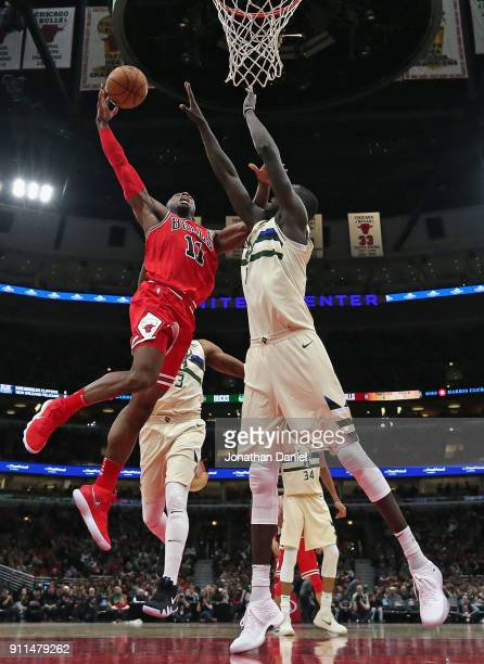 David Nwaba of the Chicago Bulls drives to the basket against Thon Maker of the Milwaukee Bucks at the United Center on January 28 2018 in Chicago...