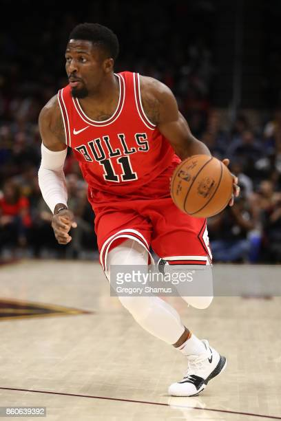 David Nwaba of the Chicago Bulls drives to the basket while playing the Cleveland Cavaliers during a pre season game at Quicken Loans Arena on...