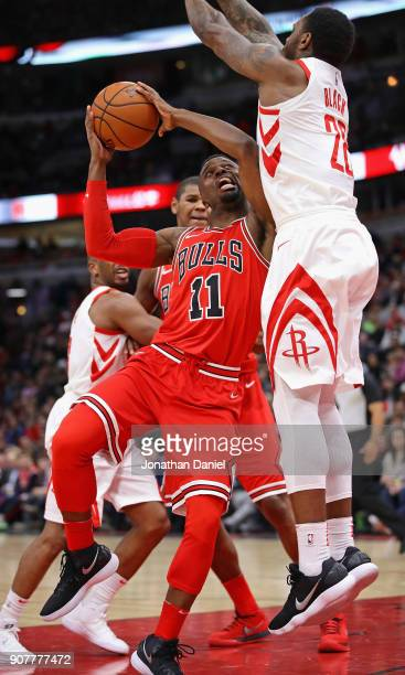 David Nwaba of the Chicago Bulls goes up against Tarik Black of the Houston Rockets at the United Center on January 8 2018 in Chicago Illinois The...