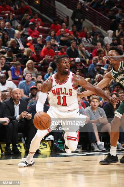 David Nwaba of the Chicago Bulls handles the ball against the Milwaukee Bucks during the preseason game on October 6 2017 at the United Center in...