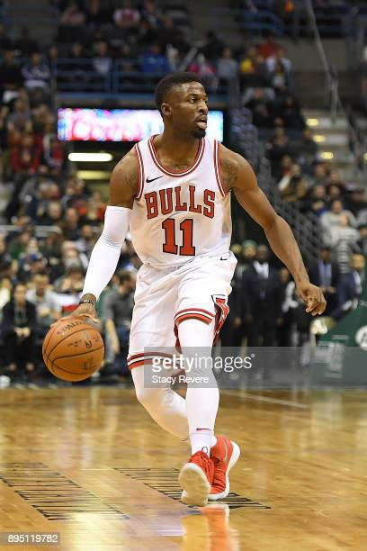 David Nwaba of the Chicago Bulls handles the ball during a game against the Milwaukee Bucks at the Bradley Center on December 15 2017 in Milwaukee...