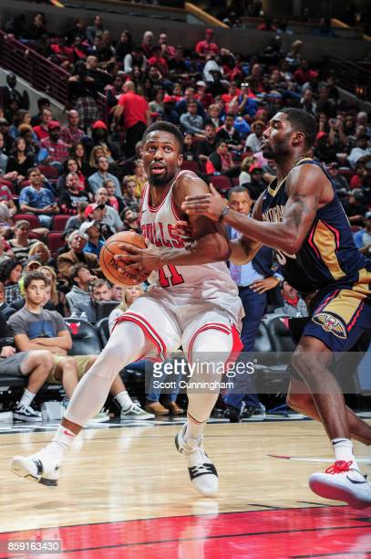 David Nwaba of the Chicago Bulls handles the ball during the preseason game against the New Orleans Pelicans on October 8 2017 at United Center in...