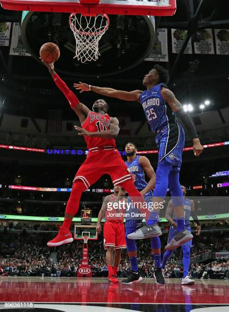 David Nwaba of the Chicago Bulls puts up a shot past Wesley Iwundu of the Orlando Magic at the United Center on December 20 2017 in Chicago Illinois...