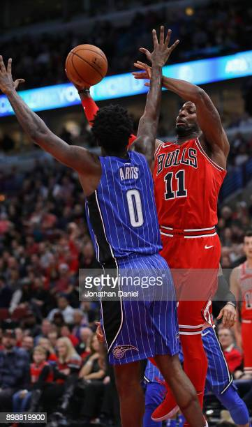 David Nwaba of the Chicago Bulls shoots against Jamel Artis of the Orlando Magic at the United Center on December 20 2017 in Chicago Illinois The...
