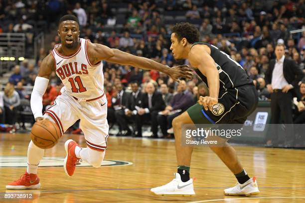 David Nwaba of the Chicago Bulls works against Malcolm Brogdon of the Milwaukee Bucks during the second half of a game at the Bradley Center on...