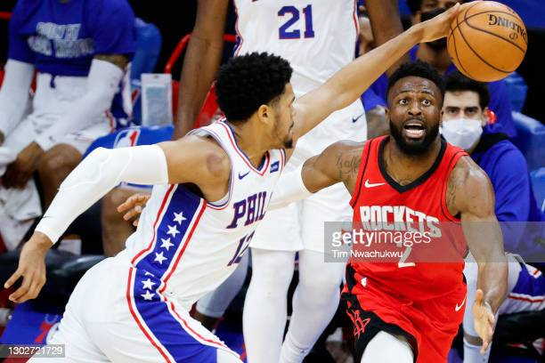 David Nwaba of the Houston Rockets reaches watches the ball during the fourth quarter against the Philadelphia 76ers at Wells Fargo Center on...