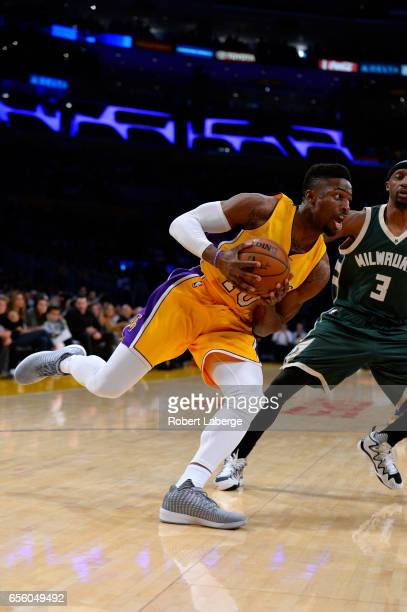 David Nwaba of the Los Angeles Lakers attacks the basket against Jason Terry the Milwaukee Bucks on March 17 2017 at STAPLES Center in Los Angeles...