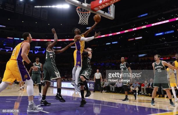David Nwaba of the Los Angeles Lakers attempts a lay up against Matthew Dellavedova of the Milwaukee Bucks on March 17 2017 at STAPLES Center in Los...