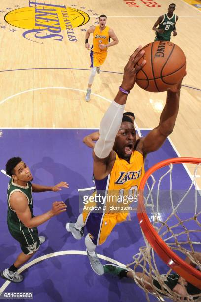 David Nwaba of the Los Angeles Lakers dunks against the Milwaukee Bucks on March 17 2017 at STAPLES Center in Los Angeles California NOTE TO USER...