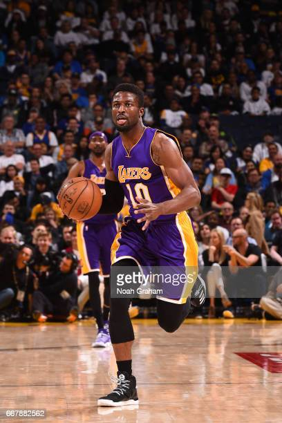 David Nwaba of the Los Angeles Lakers handles the ball against the Golden State Warriors on April 12 2017 at ORACLE Arena in Oakland California NOTE...