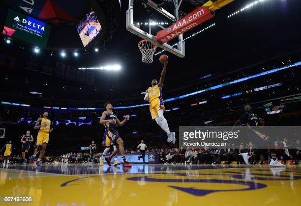 David Nwaba of the Los Angeles Lakers scores a basket against Jrue Holiday of the New Orleans Pelicans during the second half of the basketball game...