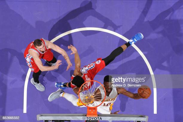 David Nwaba of the Los Angeles Lakers shoots a lay up against the Philadelphia 76ers on March 12 2017 at STAPLES Center in Los Angeles California...