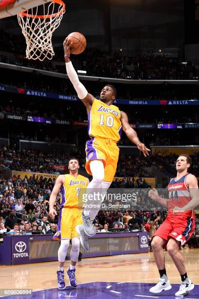 David Nwaba of the Los Angeles Lakers shoots a lay up during the game against the Washington Wizards on March 28 2017 at STAPLES Center in Los...
