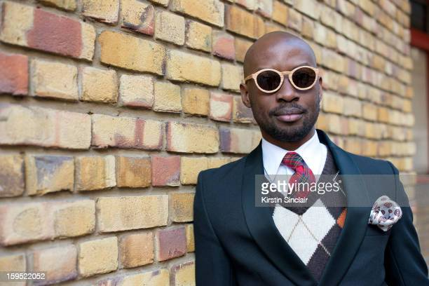 David Nyanzi photographer wearing an H and M sweater, a Dolce and Gabbana jacket, vintage tie and pocket scarf, Hugo Boss shirt and Finlay and Co...