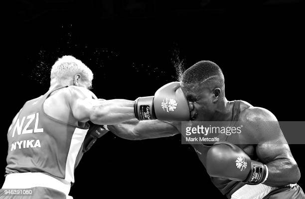 David Nyika of New Zealand and Cheavon Clarke of England compete in their Men's Heavy 91kg Semifinal bout during Boxing on day nine of the Gold Coast...