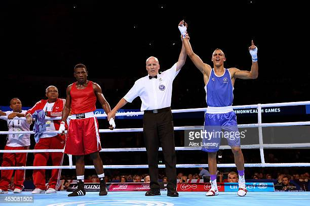 David Nyika of New Zealand celebrates winning the gold medal against Kennedy St Pierre of Mauritius in the Men's Light Heavy Final at SSE Hydro...