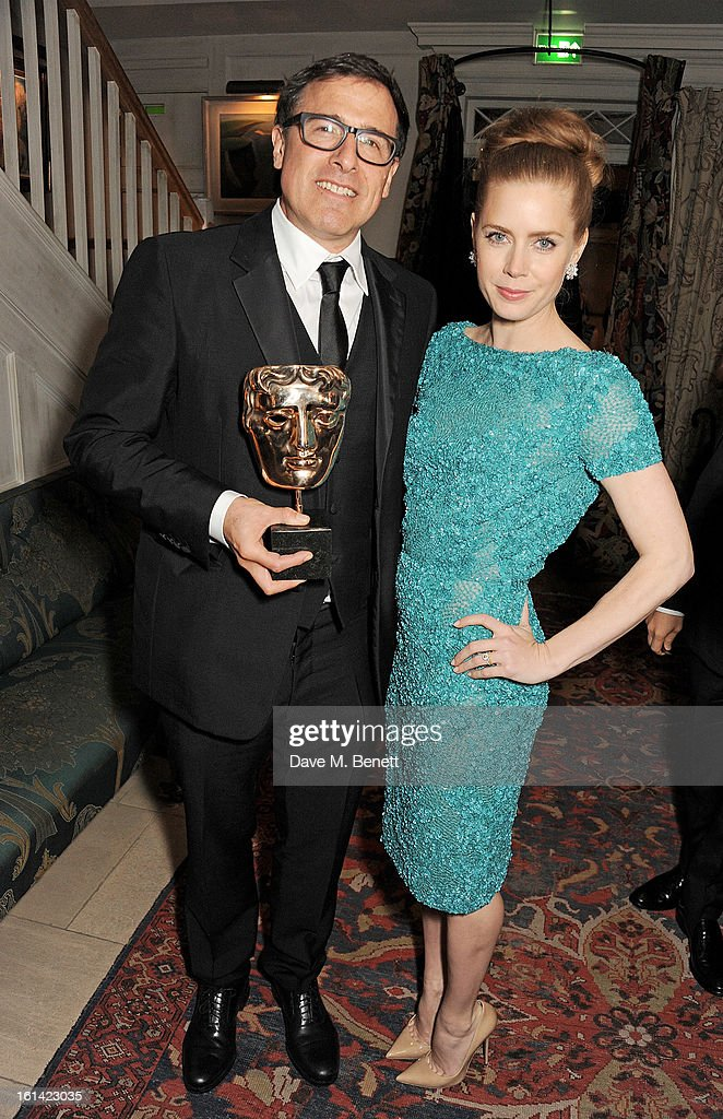 David O. Russell (L) and Amy Adams attend The Weinstein Company and Entertainment Film Distributors Post-BAFTA Party hosted by Chopard and Grey Goose at LouLou's on February 10, 2013 in London, England.