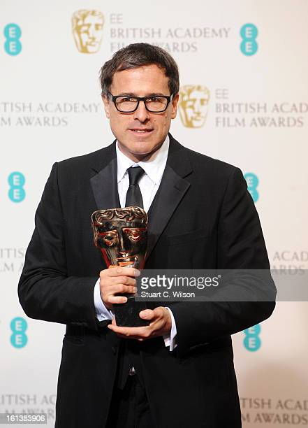 David O Russell winner of the Adapted Screenplay award for Silver Linings Playbook poses in the press room at the EE British Academy Film Awards at...