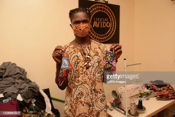 David Ochieng founder of Lookslike Avido fashion line displays some of his reusable face masks at his office in Kibera slums The selfmade fashion...
