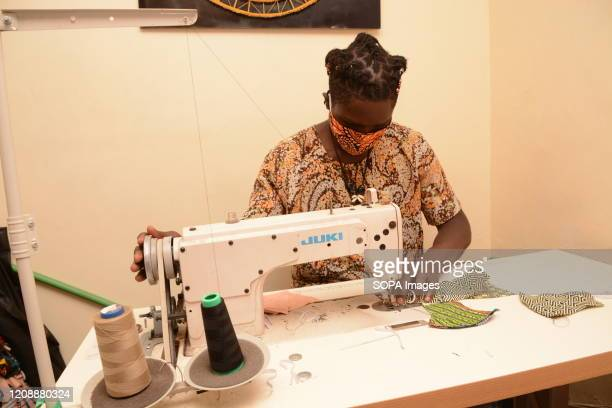 David Ochieng founder of Lookslike Avido fashion line makes reusable face masks at his office in Kibera slums The selfmade fashion designer...