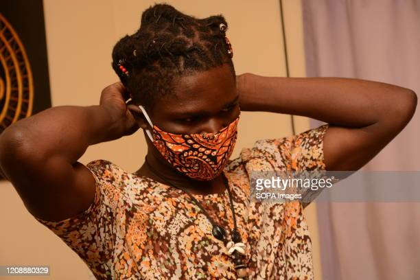 David Ochieng founder of Lookslike Avido fashion line wears one of his reusable face masks at his office in Kibera slums The selfmade fashion...