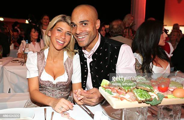 David Odonkor and his wife Suzan Odonkor during the Angermaier TrachtenNacht 2015 at Postpalast in Munich on September 3 2015 in Munich Germany