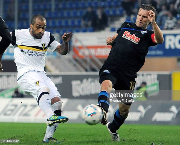 David Odonkor and Markus Kroesche of Paderborn fight for the ball during the Second Bundesliga match between SC Paderborn and Alemannia Aachen at the...