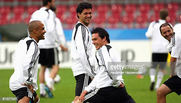 David Odonkor Michael Ballack Piotr Trochowski and Oliver Neuville of Germany smile during the training session of the German national team at the...