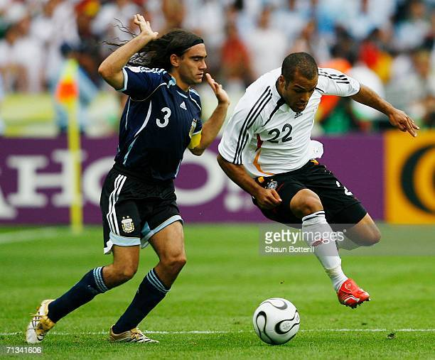 David Odonkor of Germany battles for the ball with Juan Sorin of Argentina during the FIFA World Cup Germany 2006 Quarterfinal match between Germany...