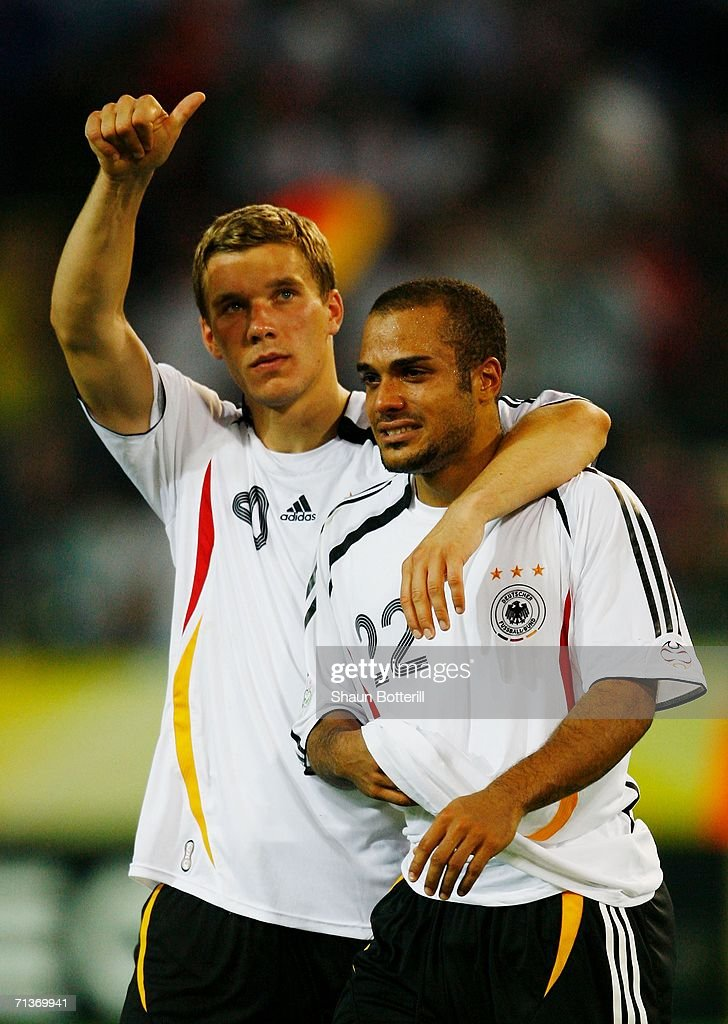David Odonkor (R) of Germany is consoled by team mate Lukas Podolski following their team's defeat at the end of the FIFA World Cup Germany 2006 Semi-final match between Germany and Italy played at the Stadium Dortmund on July 04, 2006 in Dortmund, Germany.