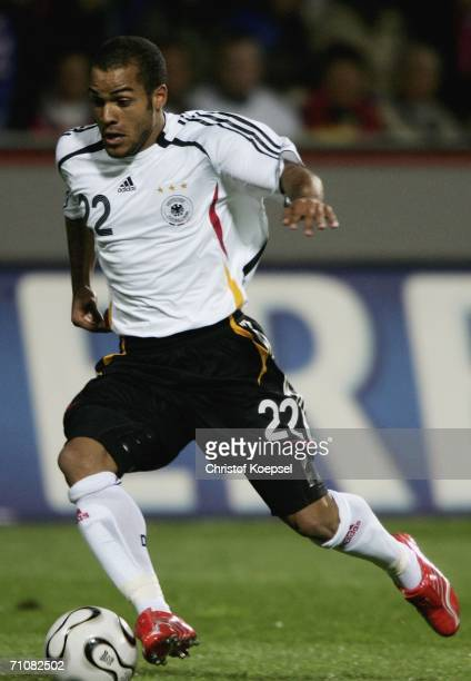 David Odonkor of Germany runs with the ball during the International Friendly match between Germany and Japan at the Bayarena on May 30, 2006 in...