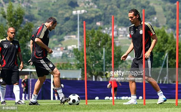 David Odonkor Oliver neuville and Kevin Kuranyi of Germany in action during a training session at the Centro Sportivo Tenero on June 20 2008 in...