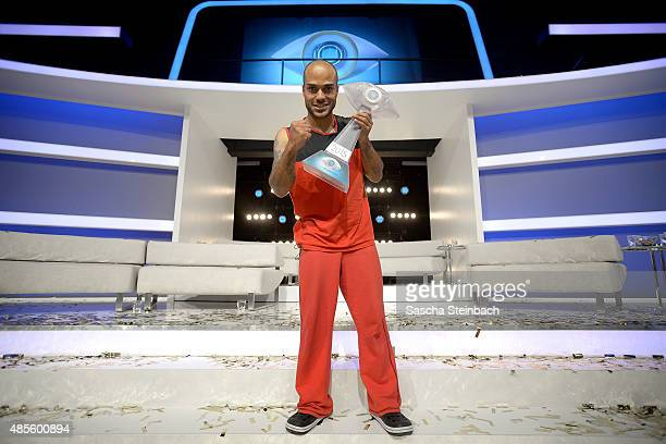 David Odonkor shows the trophy after winning the final show of Promi Big Brother 2015 at MMC studios on August 28 2015 in Cologne Germany