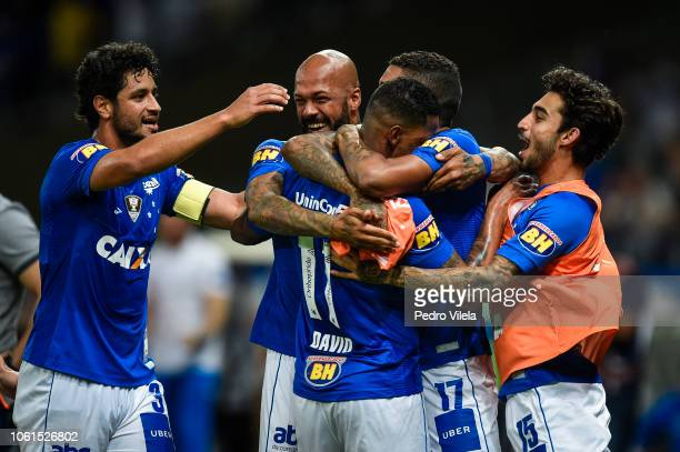 David of Cruzeiro celebrates with teammates after scoring the opening goal against Corinthians during a match between Cruzeiro and Corinthians as...