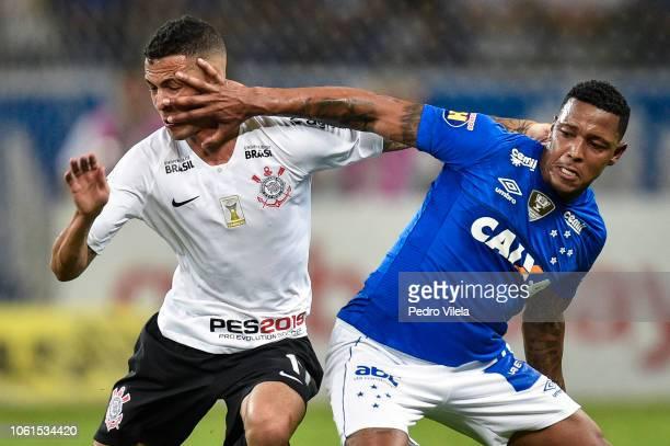 David of Cruzeiro hands off Thiaguinho of Corinthians during a match between Cruzeiro and Corinthians as part of Brasileirao Series A 2018 at...