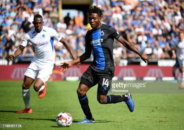 David Okereke forward of Club Brugge and John Lucumi defender of Genk during the Jupiler Pro League match between Club Brugge and KRC Genk at the Jan...