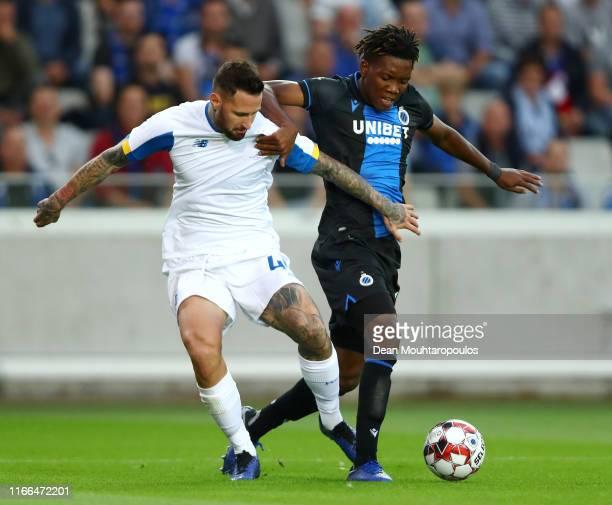 David Okereke of Club Brugge KV battles for the ball with Tamas Kadar of Football Club Dynamo Kyiv during the UEFA Champions League Third qualifying...
