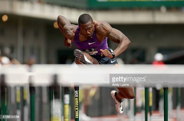 David Oliver clears a hurdle in the preliminaries of the Mens 100 meter Hurdles during day three of the 2015 USA Outdoor Track Field Championships at...