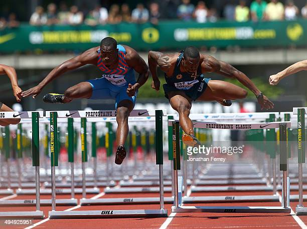 David Oliver of the United States and Hansle Parchment of Jamaica run in the 110m Hurdles during day 2 of the IAAF Diamond League Nike Prefontaine...