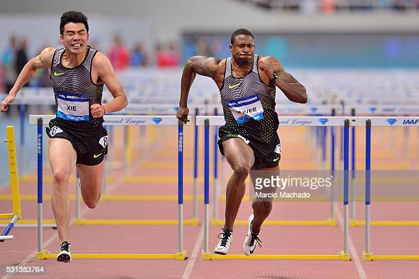 David Oliver of the United States and Xie Wenjun of China competing in the Men's 110 metres hurdles during the 2016 IAAF Diamond League at Shanghai...
