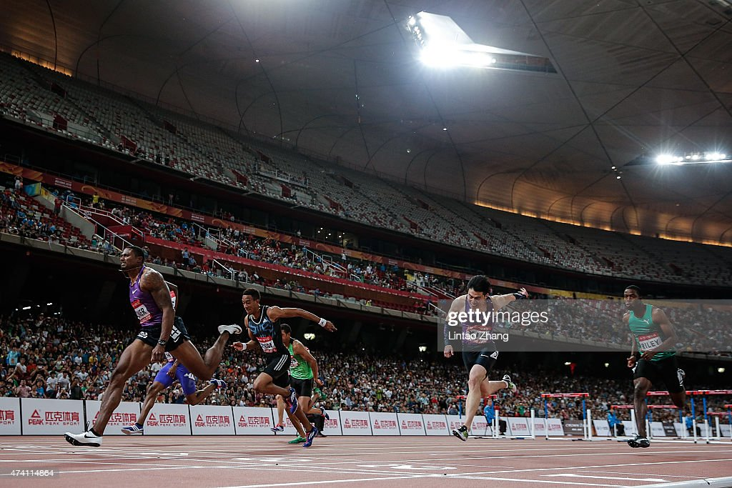David Oliver (L) of the United States crosses the finish line in the men's 110m hurdles during the 2015 IAAF World Challenge Beijing at National Stadium on May 20, 2015 in Beijing, China.