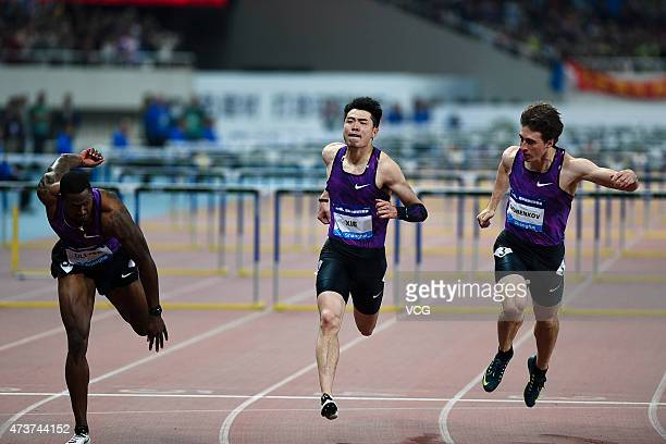 David Oliver of the United States Xie Wenjun of China and Sergey Shubenkov of Russia compete in the men's 110m hurdle event during the Shanghai IAAF...