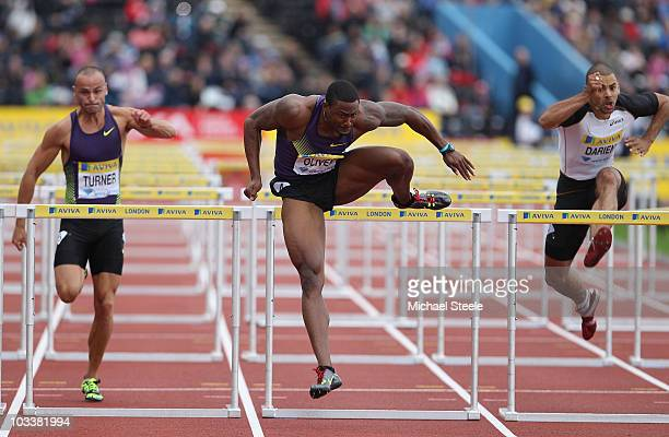 David Oliver of USA wins the men's 110m hurdles from Andy Turner of Great Britain and Garfield Darien of France during the Aviva London Grand Prix at...