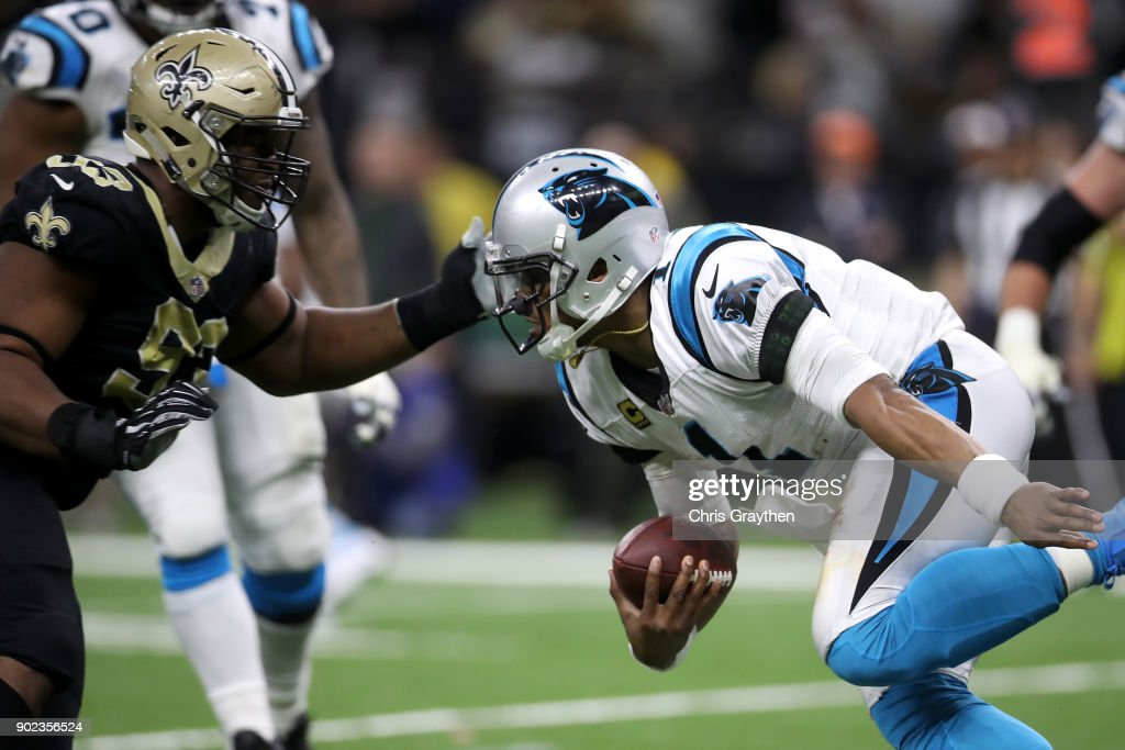 David Onyemata #93 of the New Orleans Saints tackles Cam Newton #1 of the Carolina Panthers at the Mercedes-Benz Superdome on January 7, 2018 in New Orleans, Louisiana.