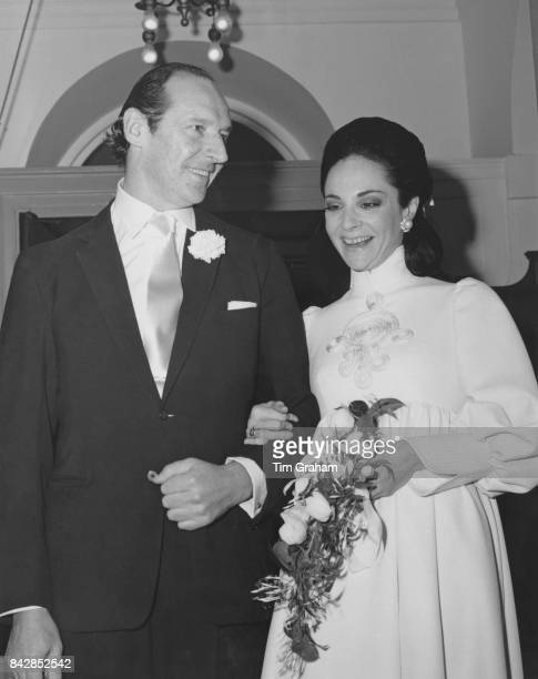 David OrmsbyGore 5th Baron Harlech formerly the British Ambassador to the United States marries Pamela Colin formerly the London editor of 'Vogue'...