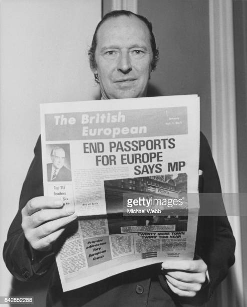 David OrmsbyGore 5th Baron Harlech holds a copy of the free newspaper 'The British European' at a press conference on the Common Market UK 25th...