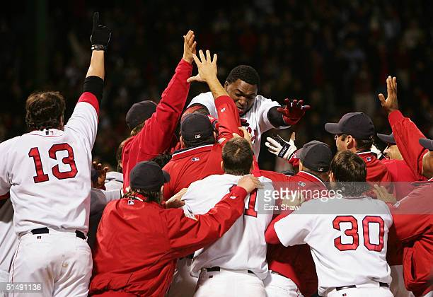 David Ortiz celebrates with his teammates after hitting the game winning tworun home run against the New York Yankees in the twelfth inning during...