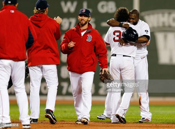 David Ortiz celebrates with Jarrod Saltalamacchia of the Boston Red Sox after defeating the Detroit Tigers 65 in Game Two of the American League...