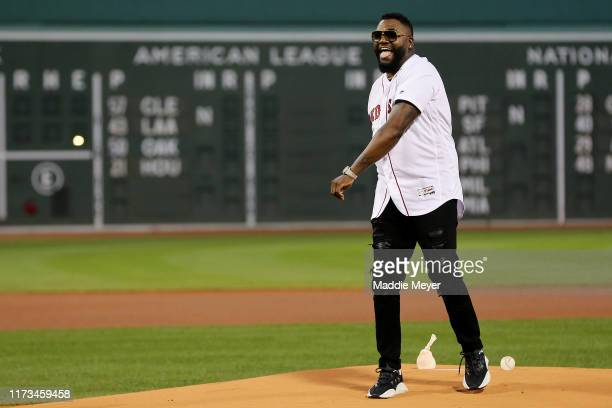 David Ortiz laughs after throwing out the ceremonial first pitch before the game between the Boston Red Sox and the New York Yankees at Fenway Park...