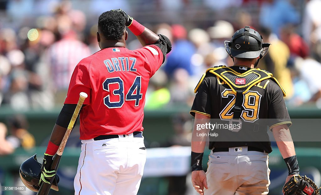 David Ortiz #34 of the Boston Red Sox and catcher Francisco Cervelli #29 of the Pittsburgh Pirates both looks into the crowd after a foul ball is hit into the crowd during the fifth inning of the Spring Training Game on March 14, 2016 at Jet Blue Park at Fenway South, Florida. The Pirates defeated the Red Sox 3-1.